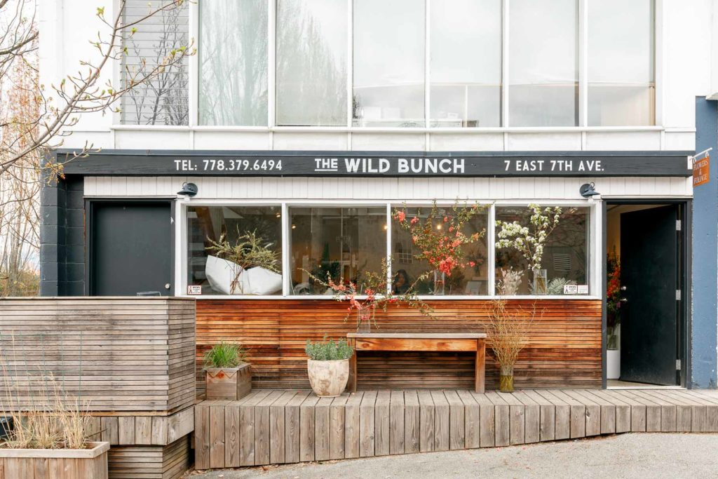 Wild Bunch Exterior with Flowers in Window and Wooden Bench Outside