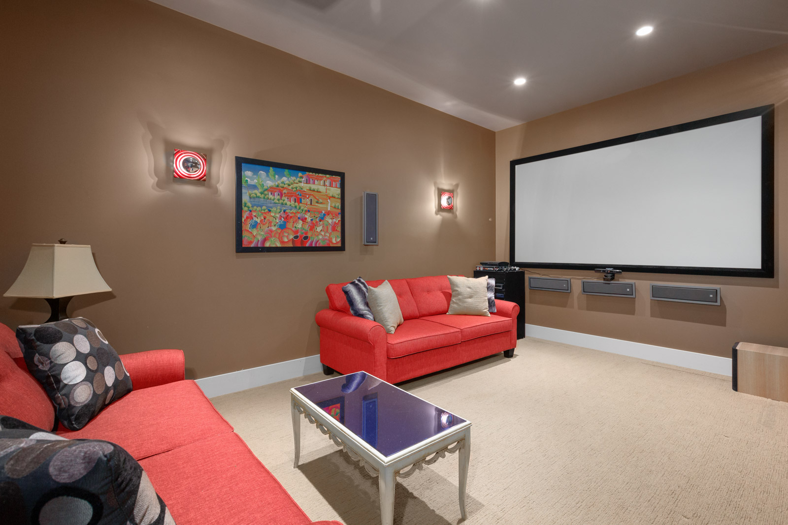 Home theatre with red couches