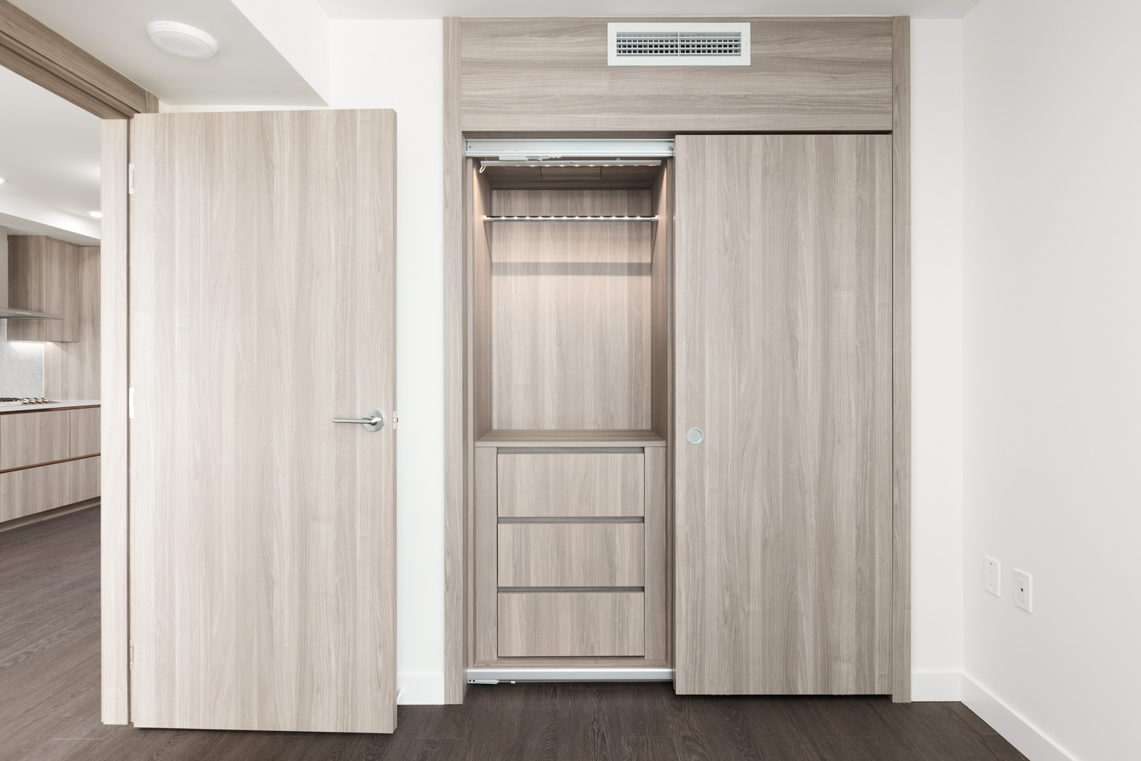 Closet with built-ins at Marine and Cambie condo