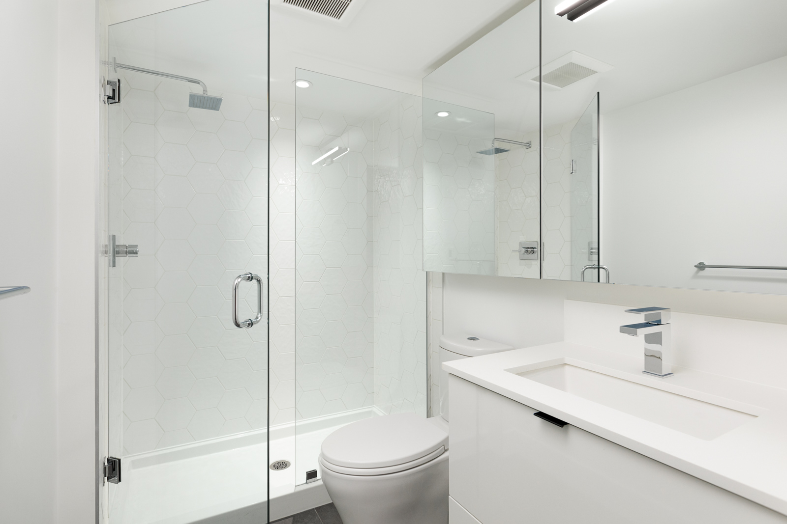 Bathroom with walk-in shower in Vancouver rental condo.