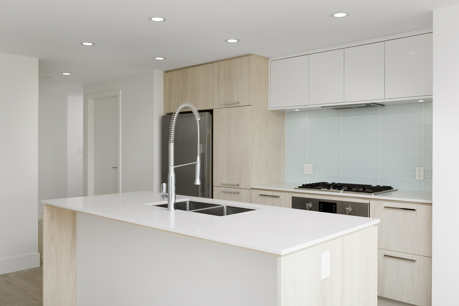 Newly renovated kitchen with stainless steel appliances in North Vancouver condo.
