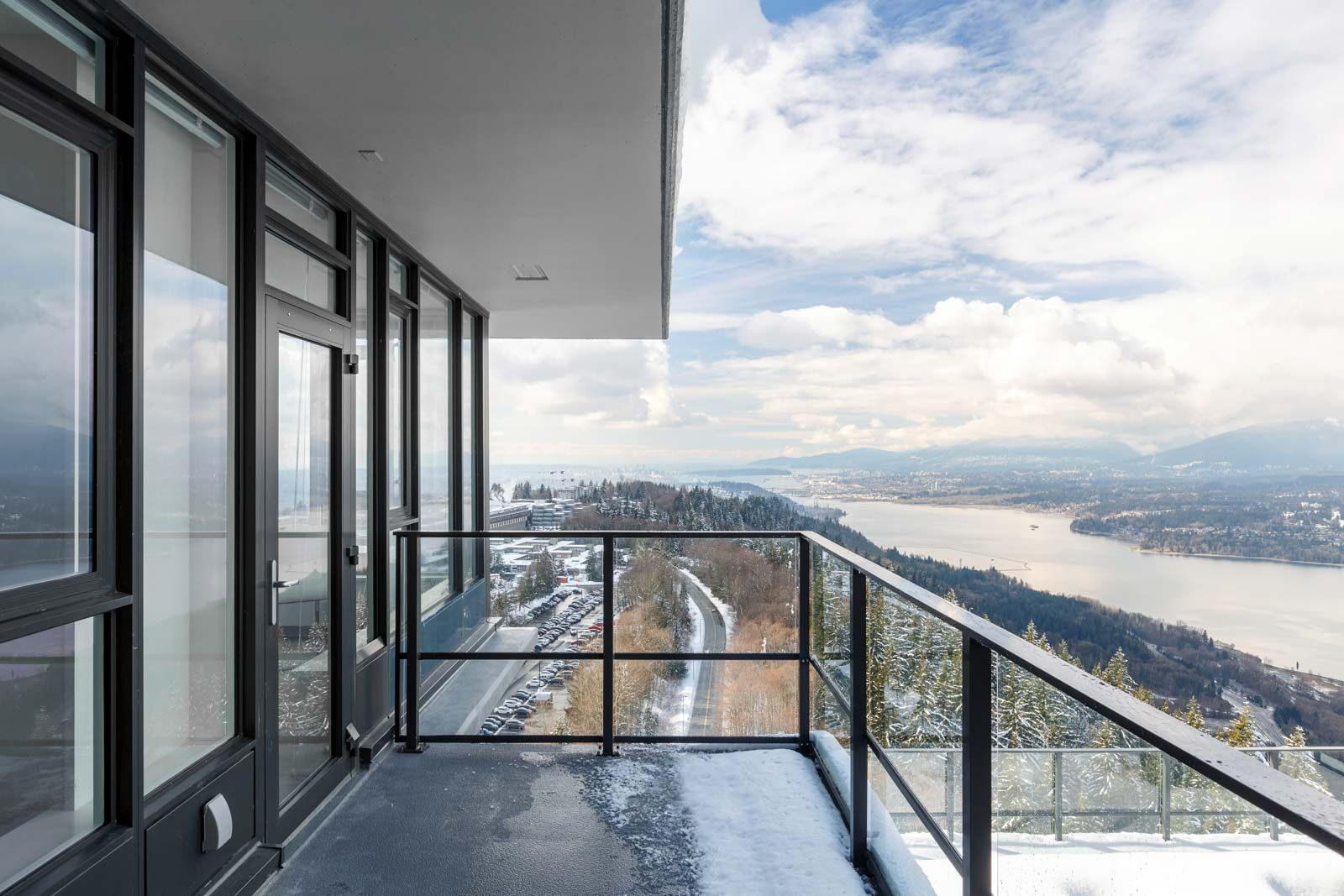 Waterfront view from private balcony of Burnaby Mountain luxury rental penthouse.