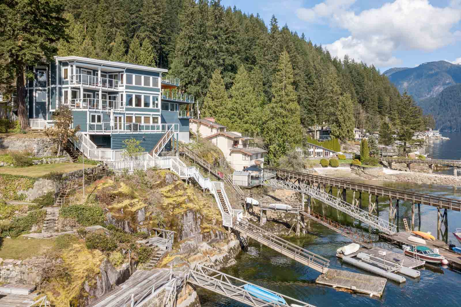 Cliffside view of private deck and waterfront of North Vancouver luxury rental home.