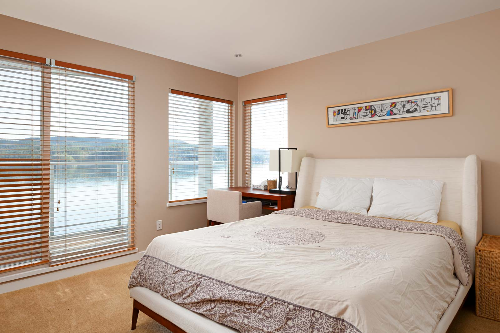 North Vancouver luxury bedroom overlooking waterfront view.