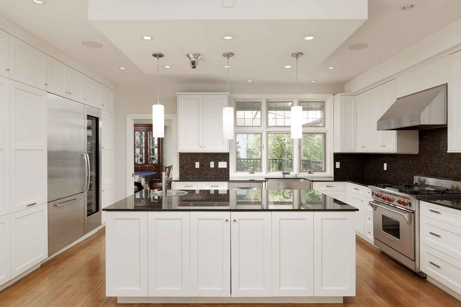 Kitchen with large island inside Vancouver luxury rental home.