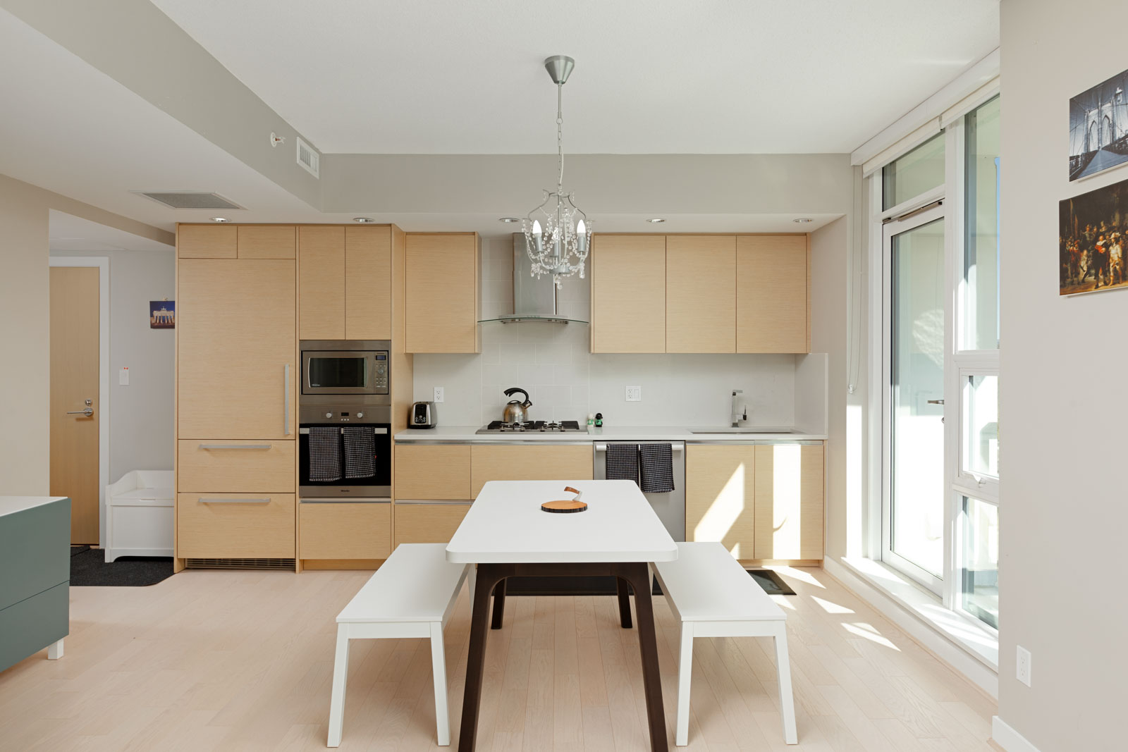 Kitchen with stainless steel appliances in Vancouver condo rental.