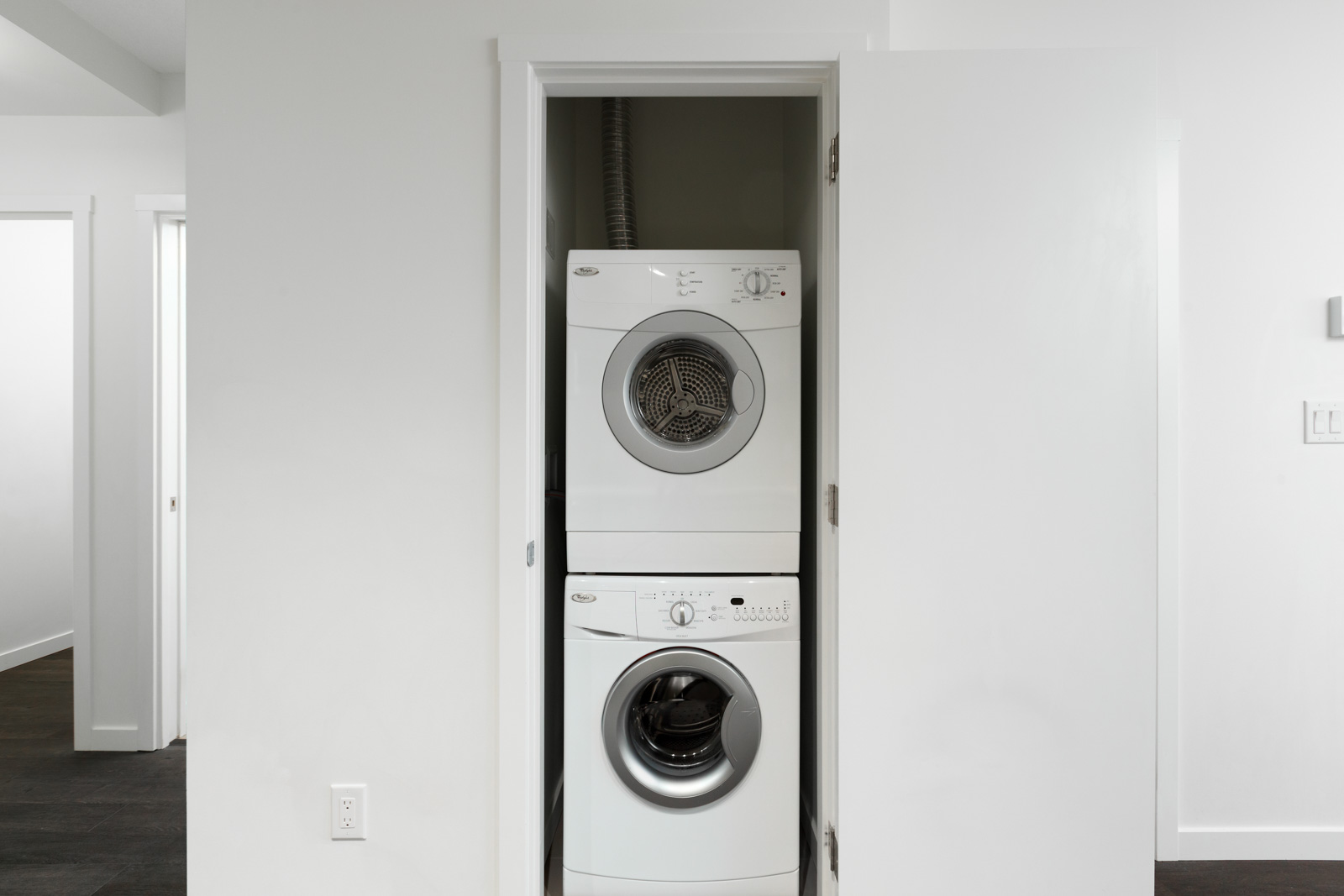 Stacked washer and dryer in East Vancouver rental condo.