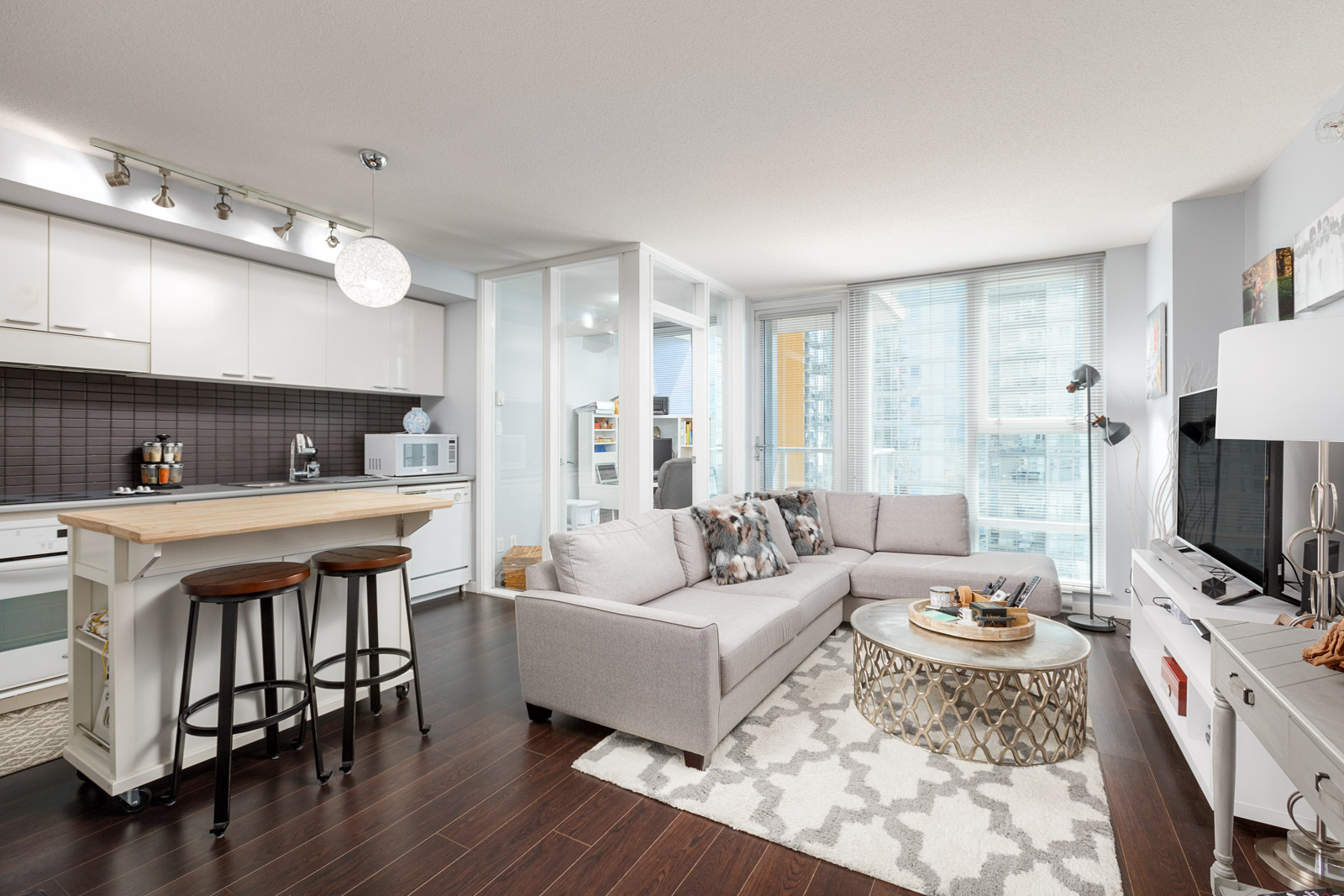 Living area in Downtown Vancouver rental condo with access to views of the city.