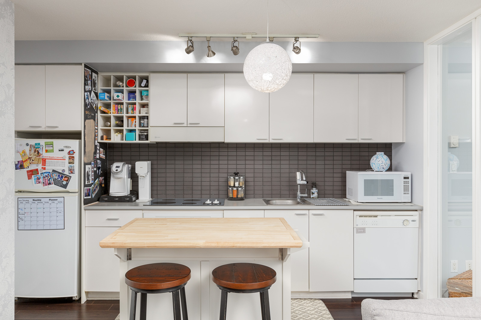 Kitchen in Downtown Vancouver rental condo with island and accompanying bar stools.