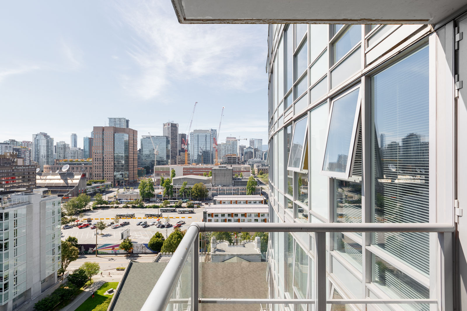 Private balcony of Downtown Vancouver rental condo overlooking the city.