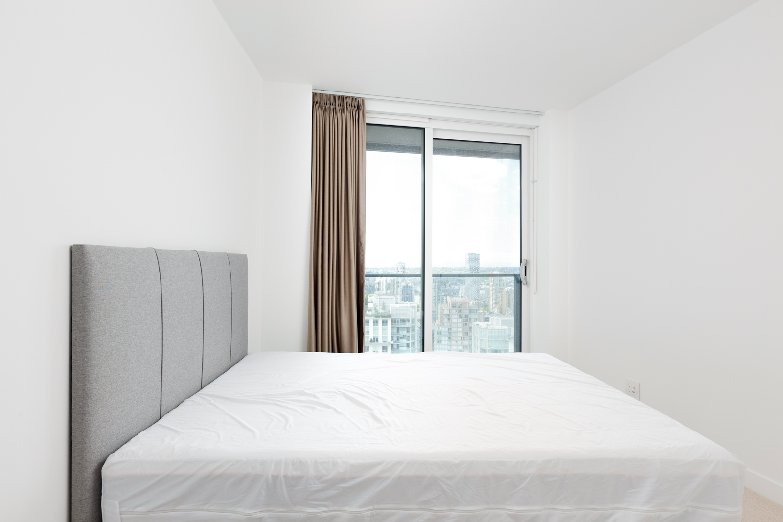 Bedroom in Downtown Vancouver condo with view.