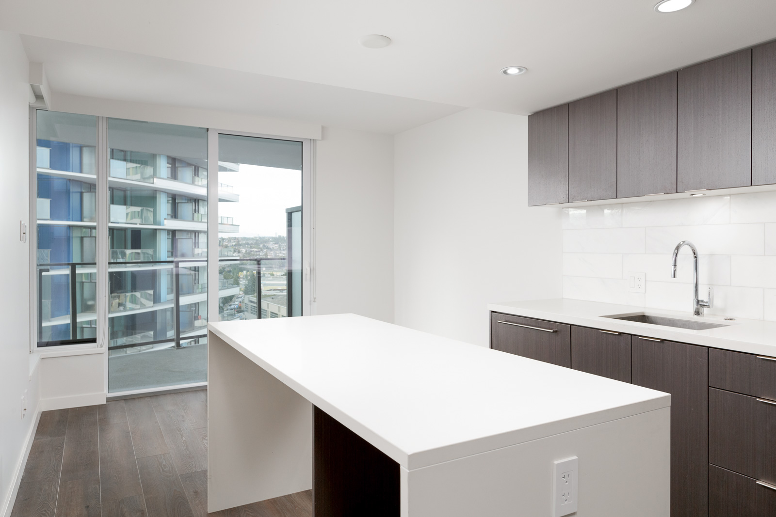 White kitchen island in luxury Vancouver condo.