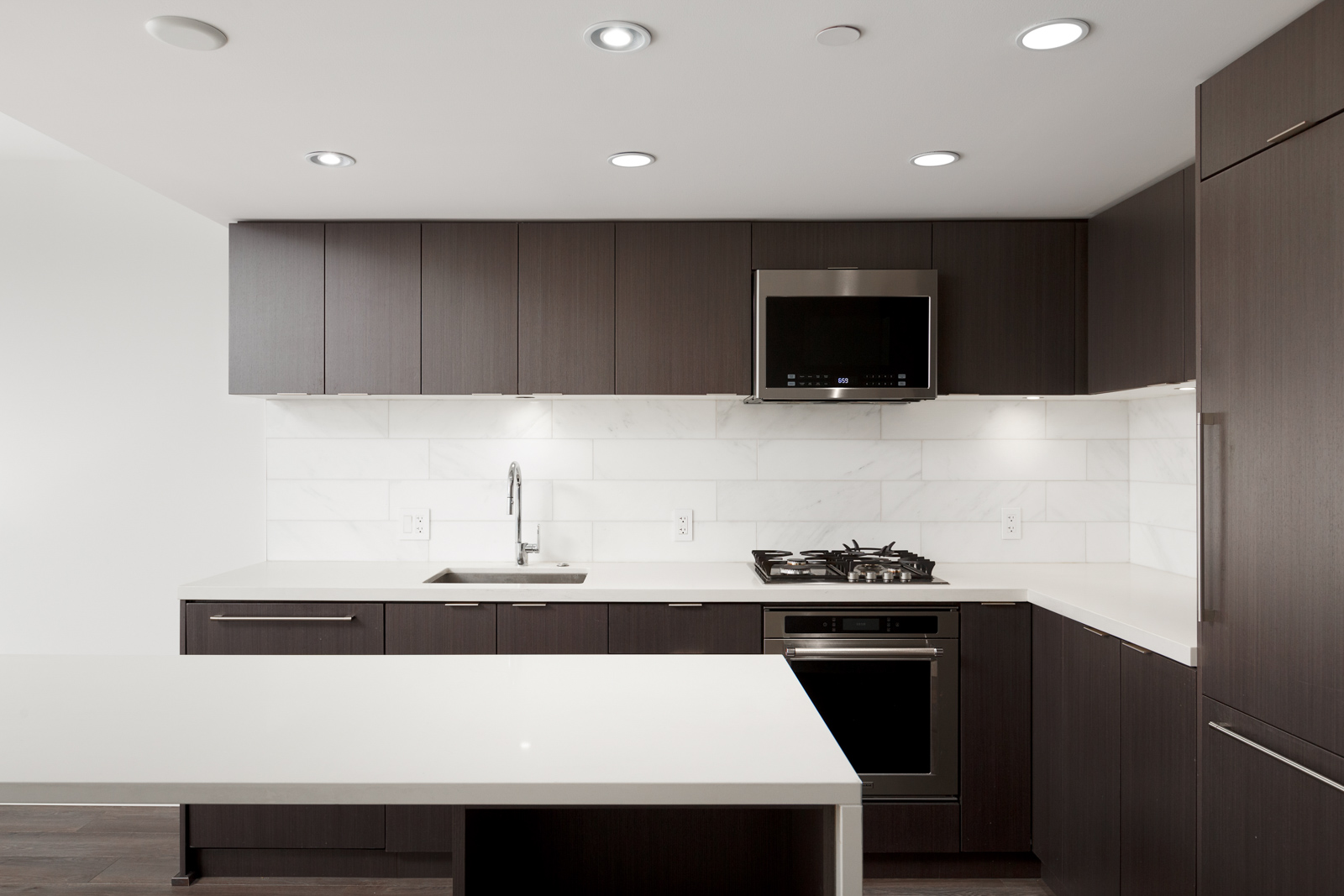 Kitchen with stainless steel appliances inside luxury Downtown Vancouver condo.