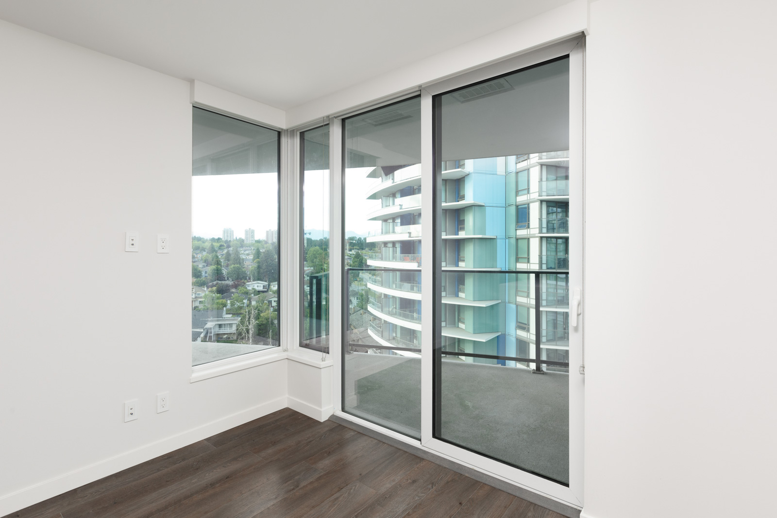 Sliding door to private balcony of luxury Vancouver rental condo.
