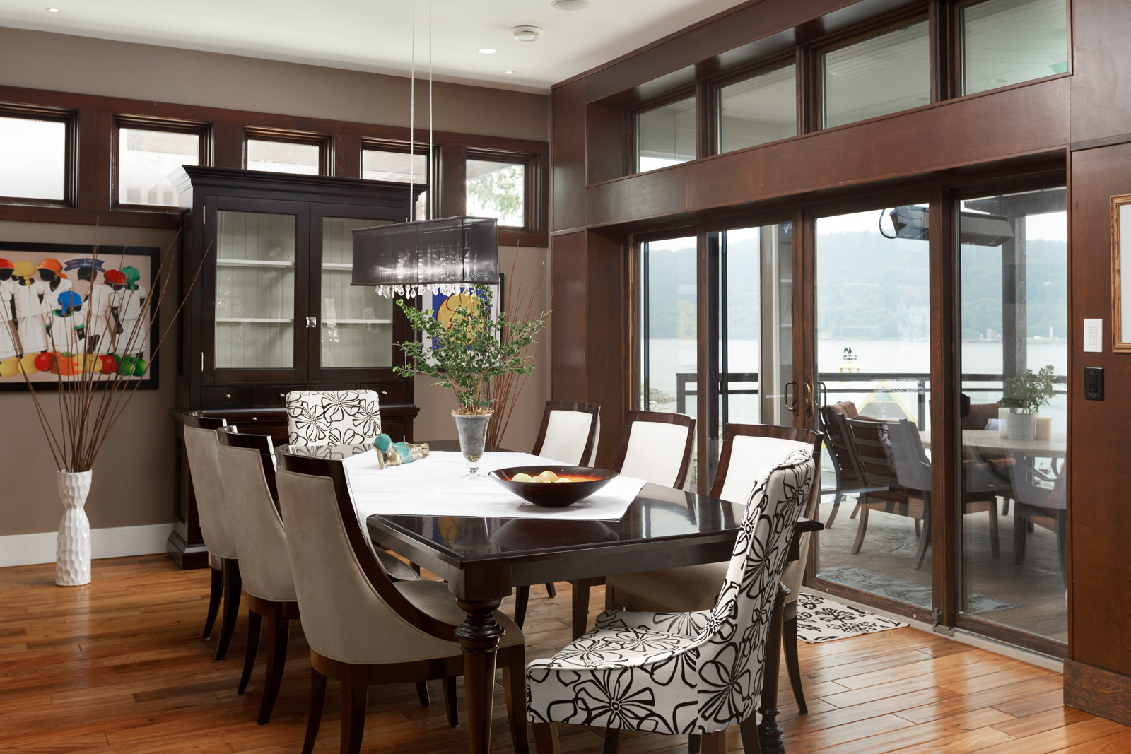 Dining room with waterfront view of Vancouver's North Shore.