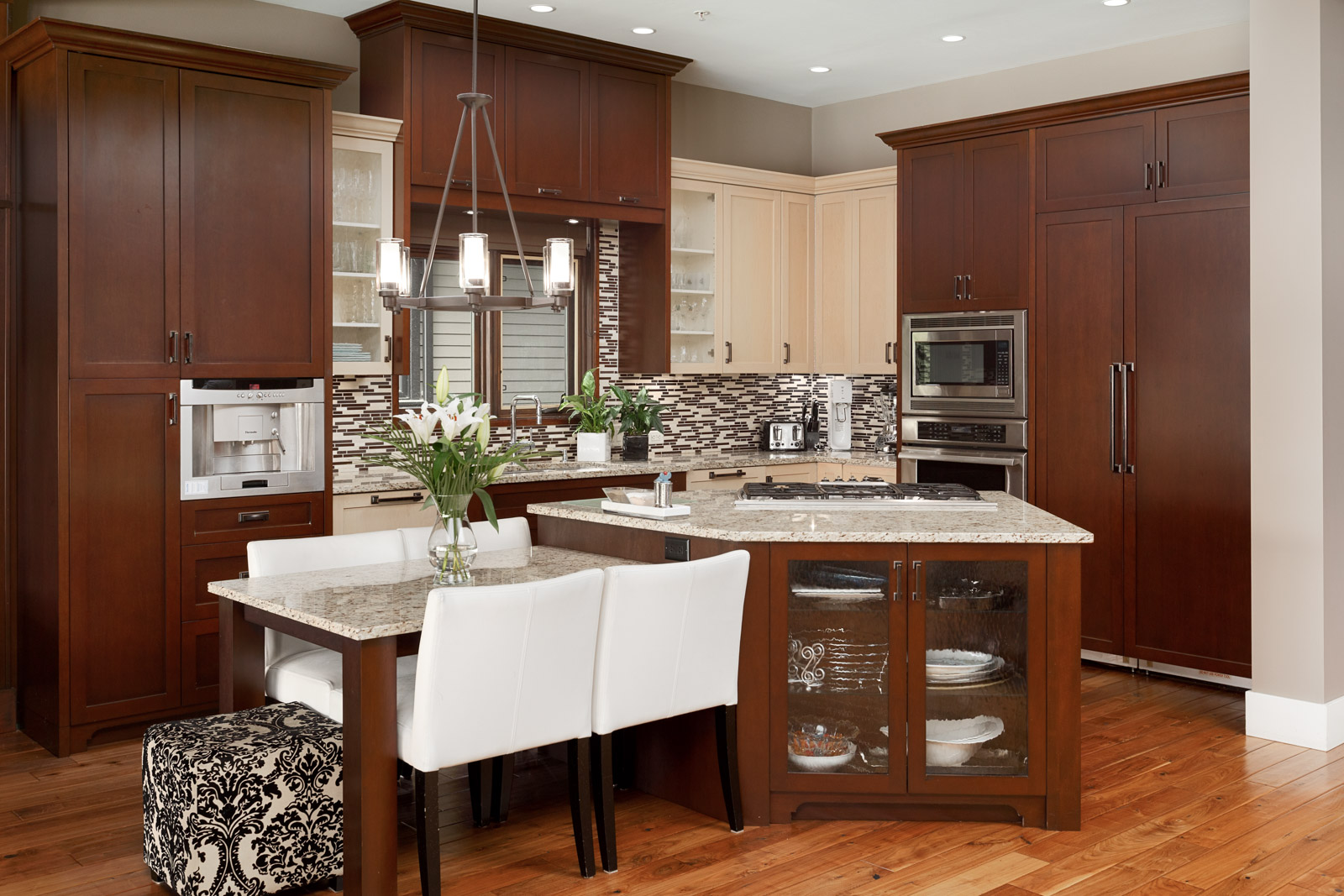 Kitchen with mahogany cabinetry inside North Vancouver luxury rental home.