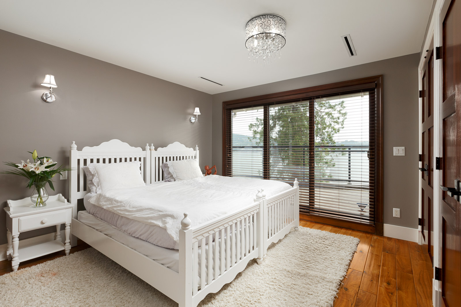 Bedroom inside North Vancouver luxury rental with waterfront view.