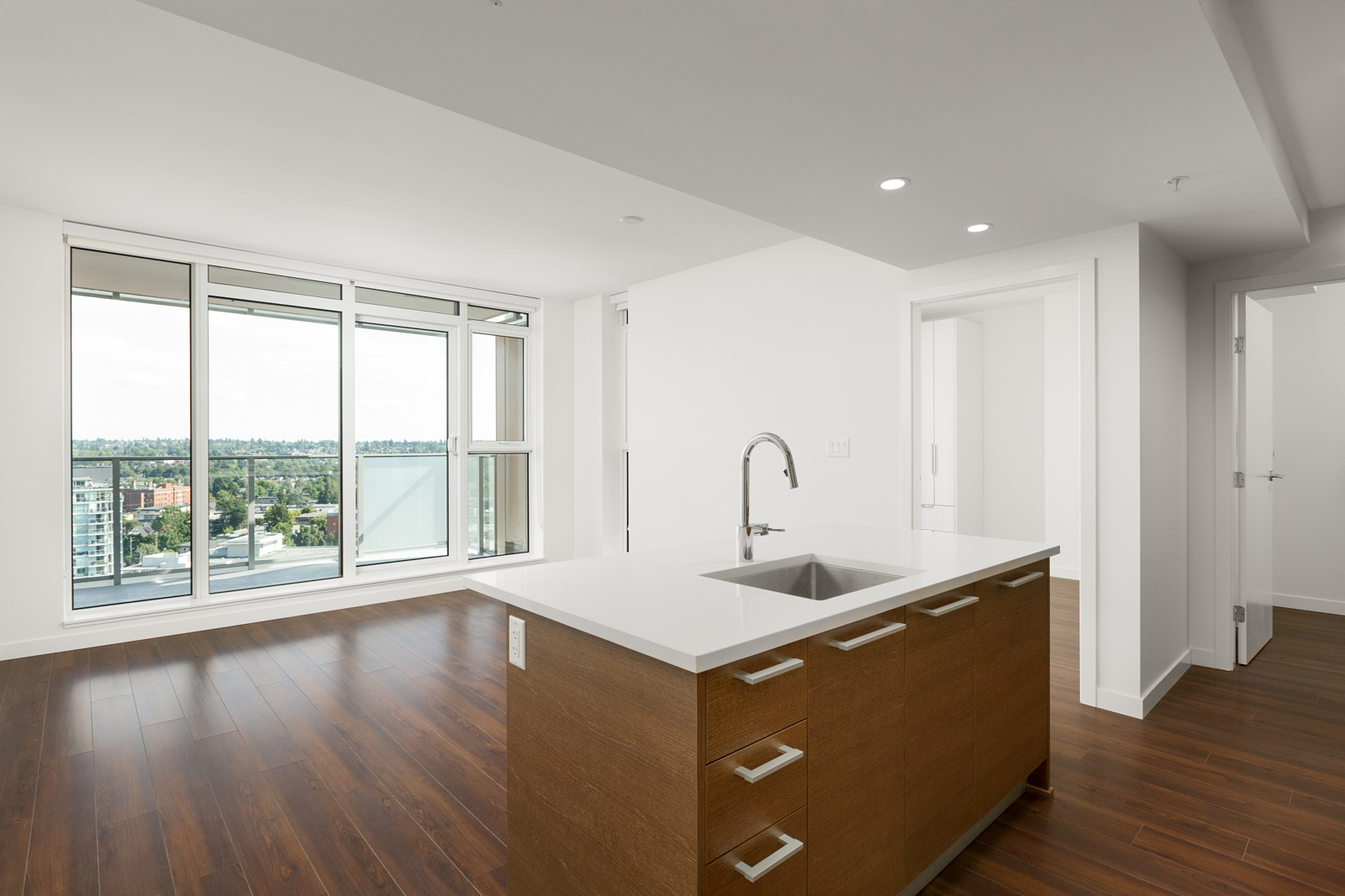 Kitchen island overlooking dining area with access to views of Vancouver's Mount Pleasant.