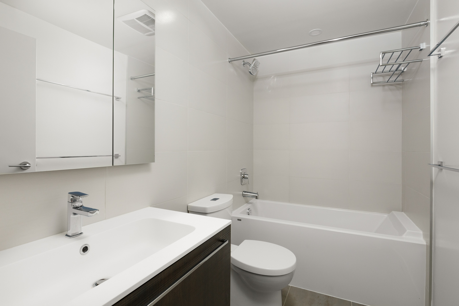 Bathroom with stand up tub inside Vancouver rental condo.