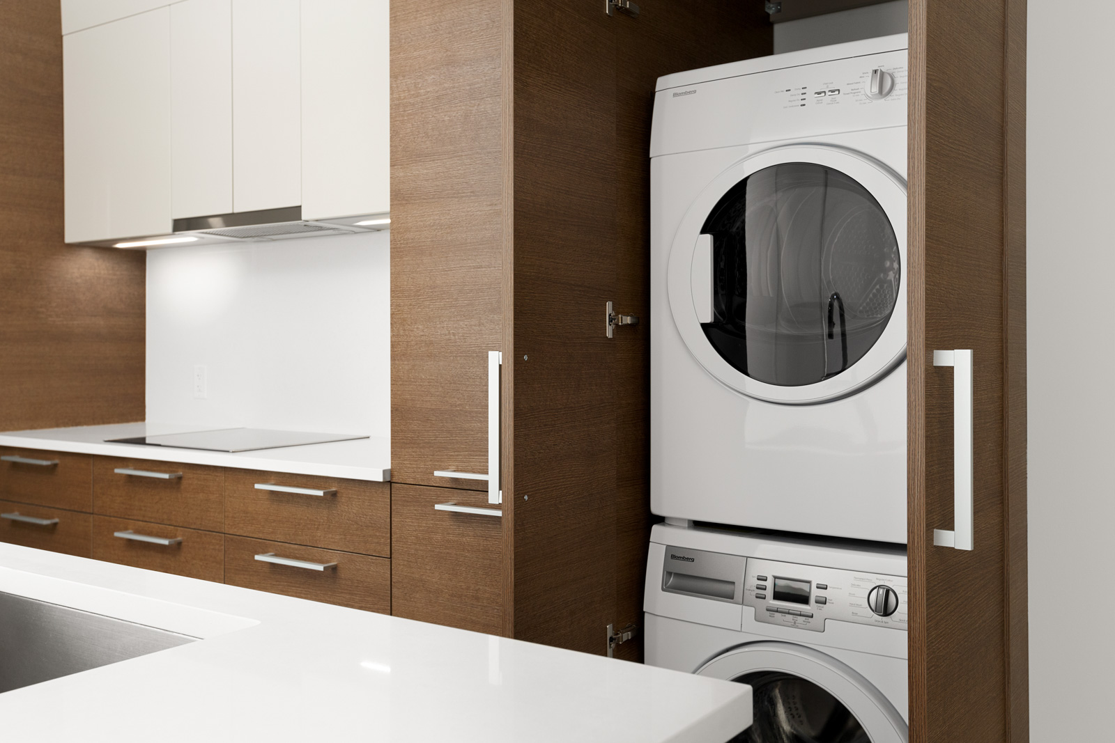 Stacked washer and dryer inside Vancouver rental condo.