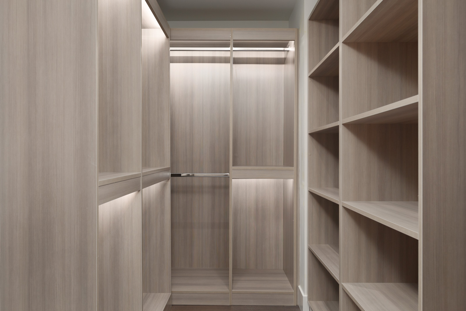 Walk-in closet with built-in lighting inside luxury Vancouver rental condo.