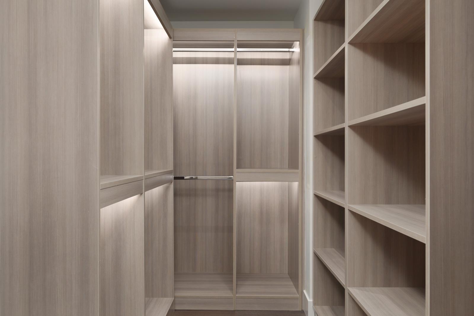 Walk-in closet with built-in lighting inside luxury Vancouver rental condo.
