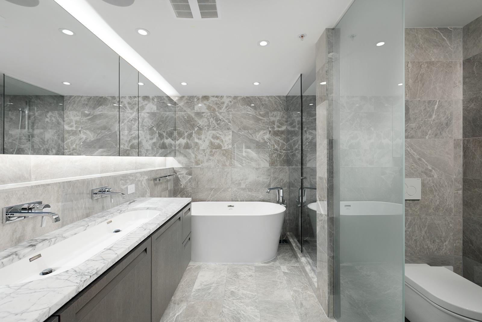 Bathroom with marbled grey tile inside luxury Vancouver rental.