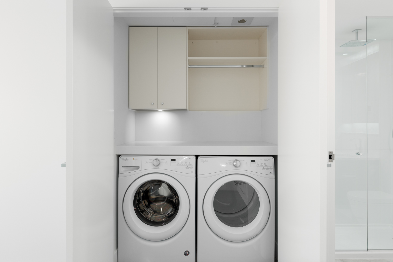 Washer and dryer closet inside luxury Vancouver rental.