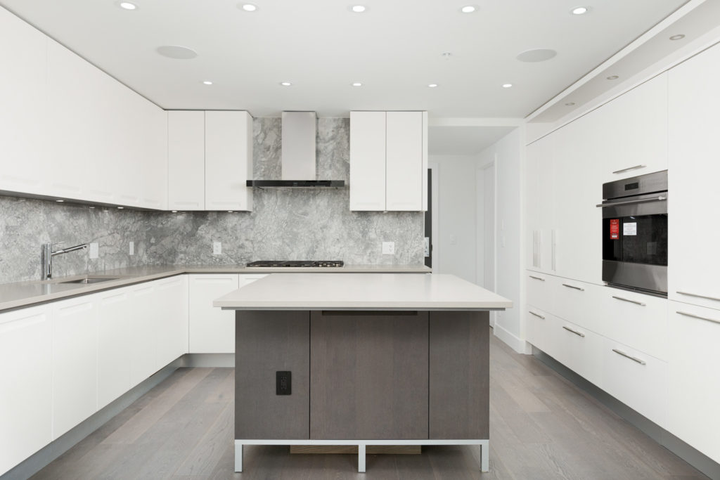 Kitchen with grey and white colour scheme inside luxury Vancouver rental condo.