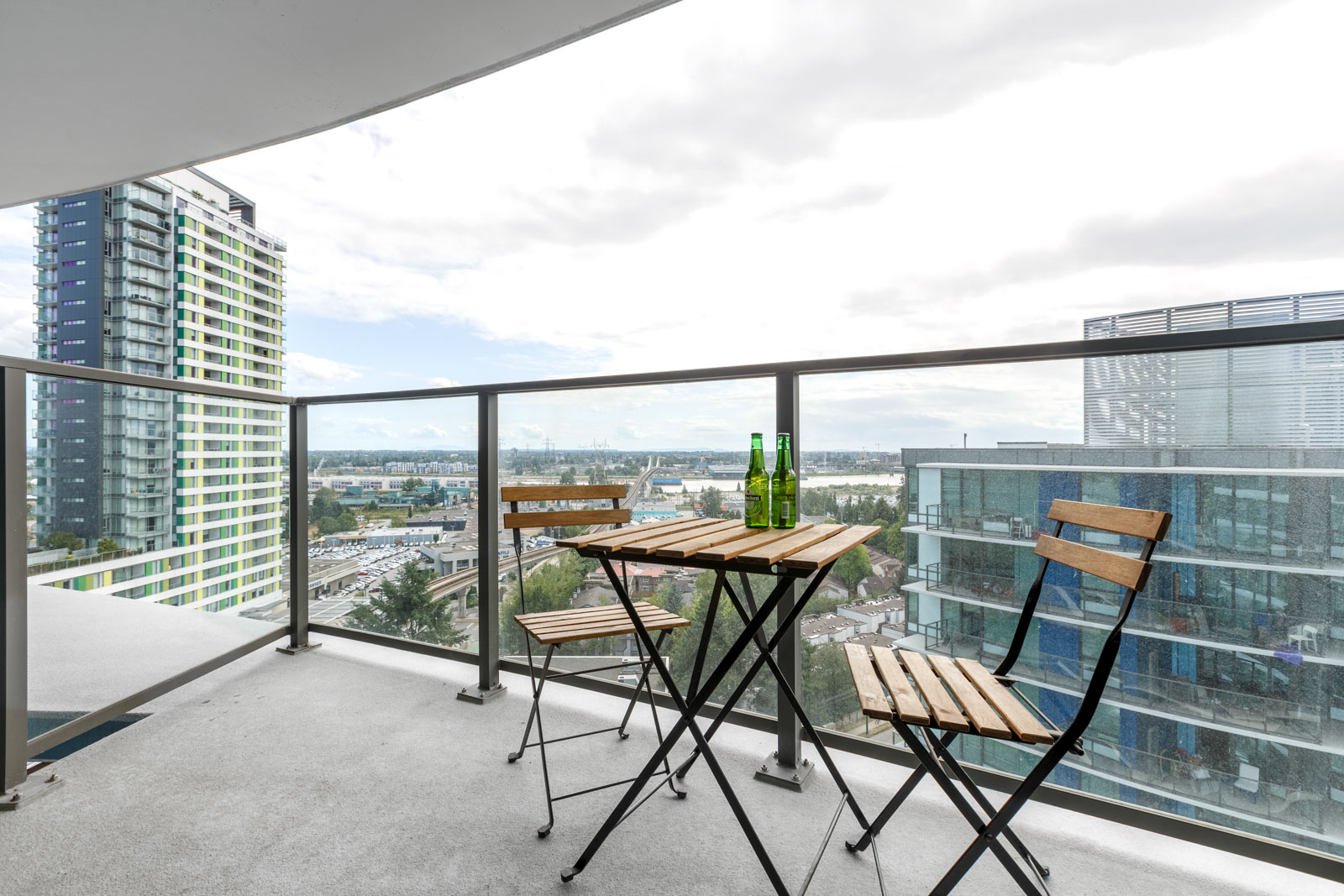 Private balcony with views of Vancouver city skyline from luxury furnished rental.
