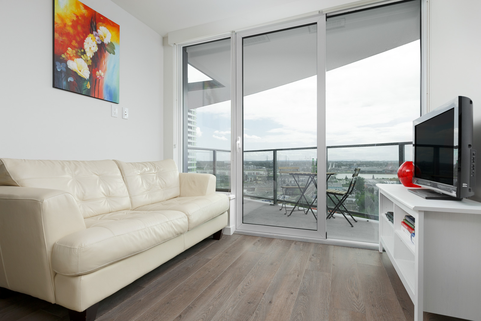 Living room inside luxury Vancouver condo with access to private balcony.