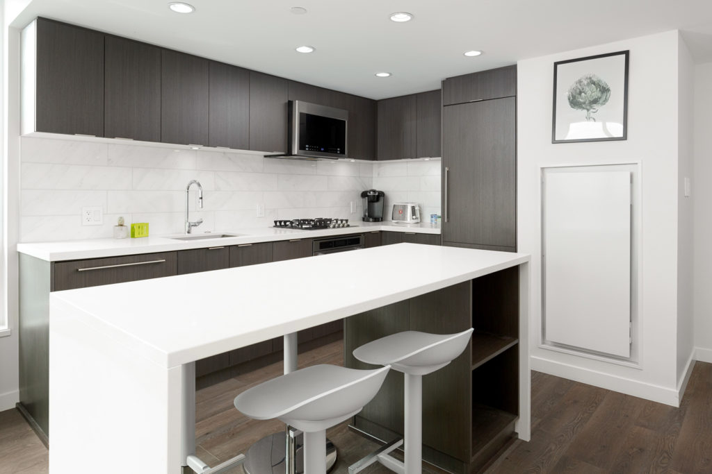 Kitchen with sit-down bar in Vancouver luxury rental.