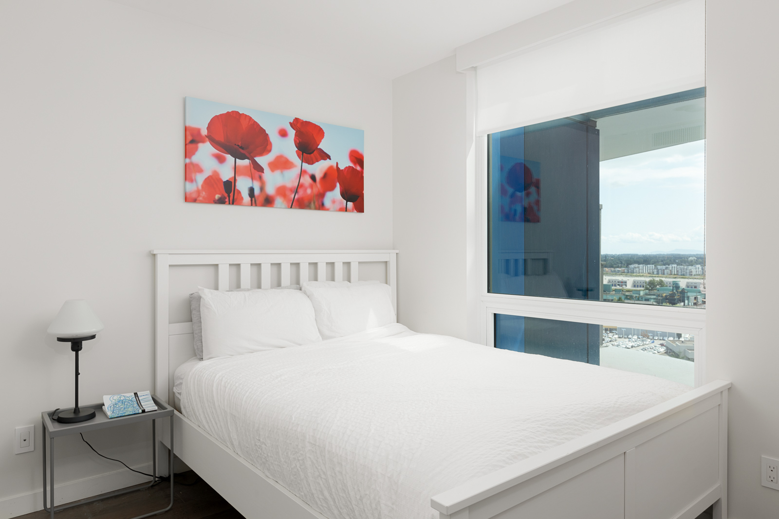 Bedroom inside luxury rental condo with views of Vancouver.