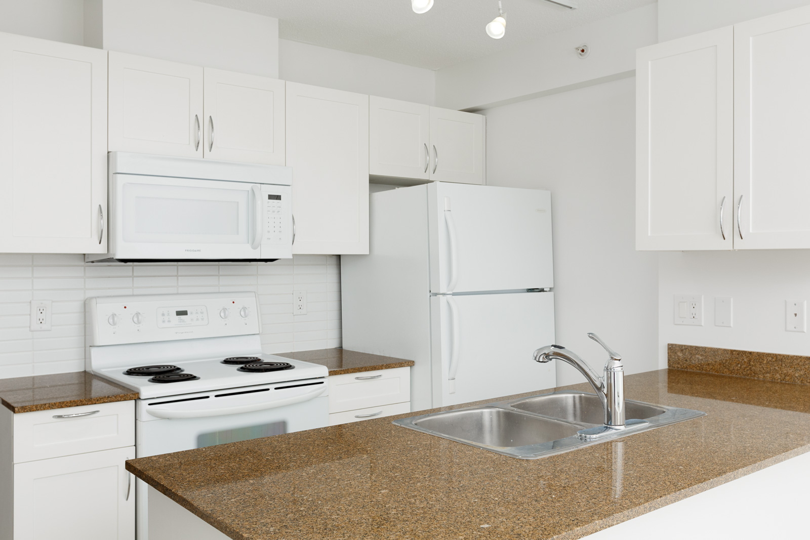 Kitchen inside Downtown Vancouver rental condo.