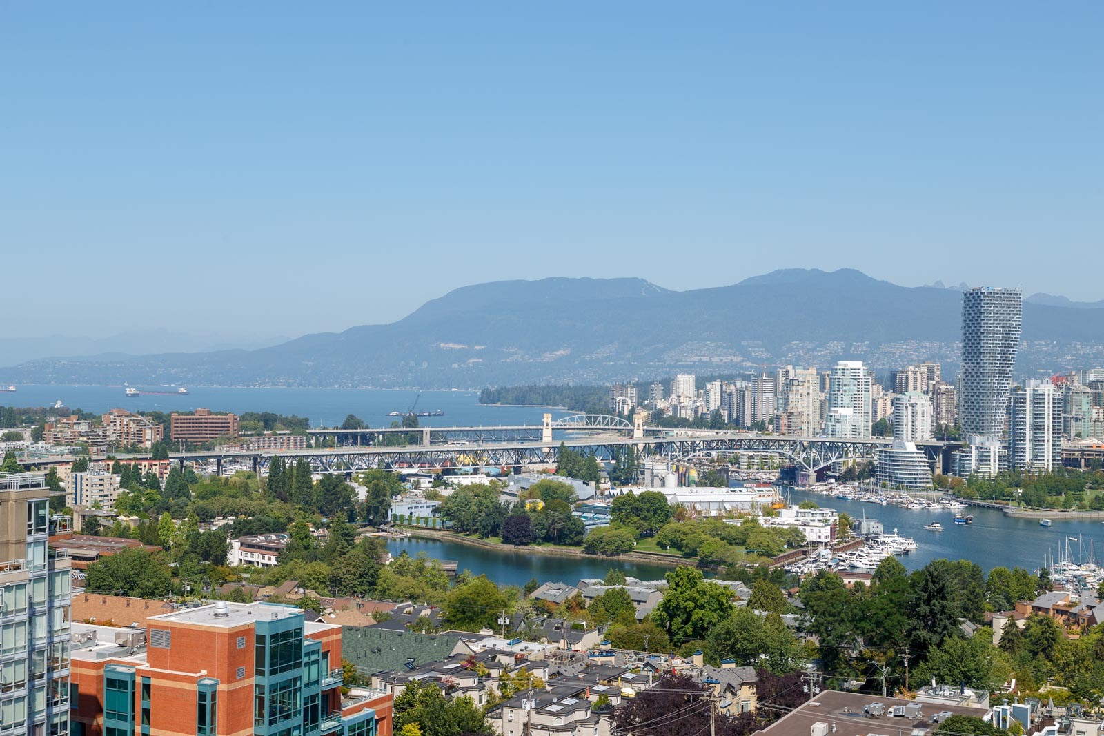 View of Vancouver city skyline from rental property managed penthouse.