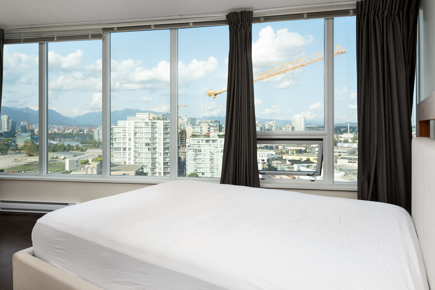 Bedroom in Vancouver rental condo with views of the city.