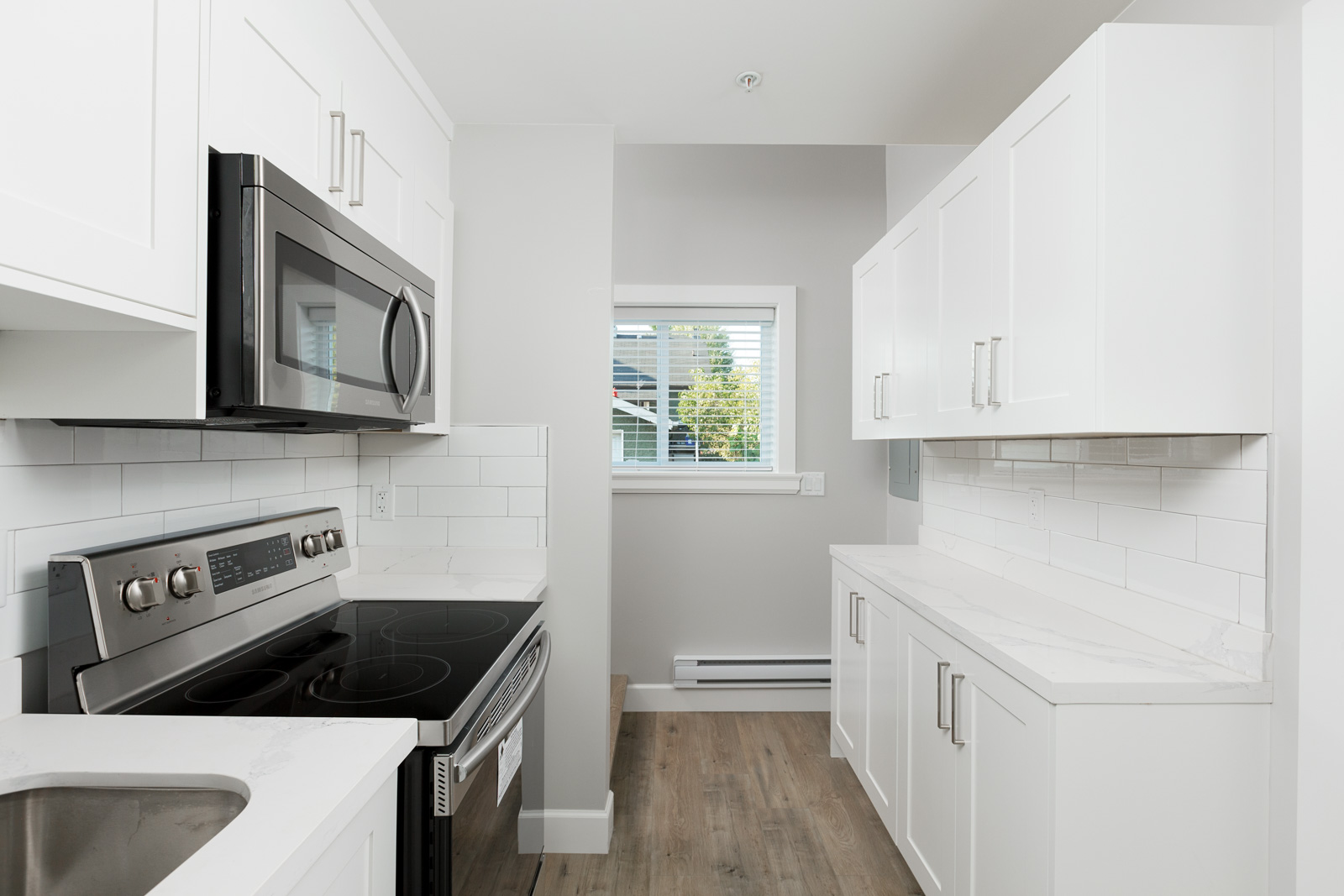 Kitchen of Vancouver unfurnished rental with stainless steel appliances.