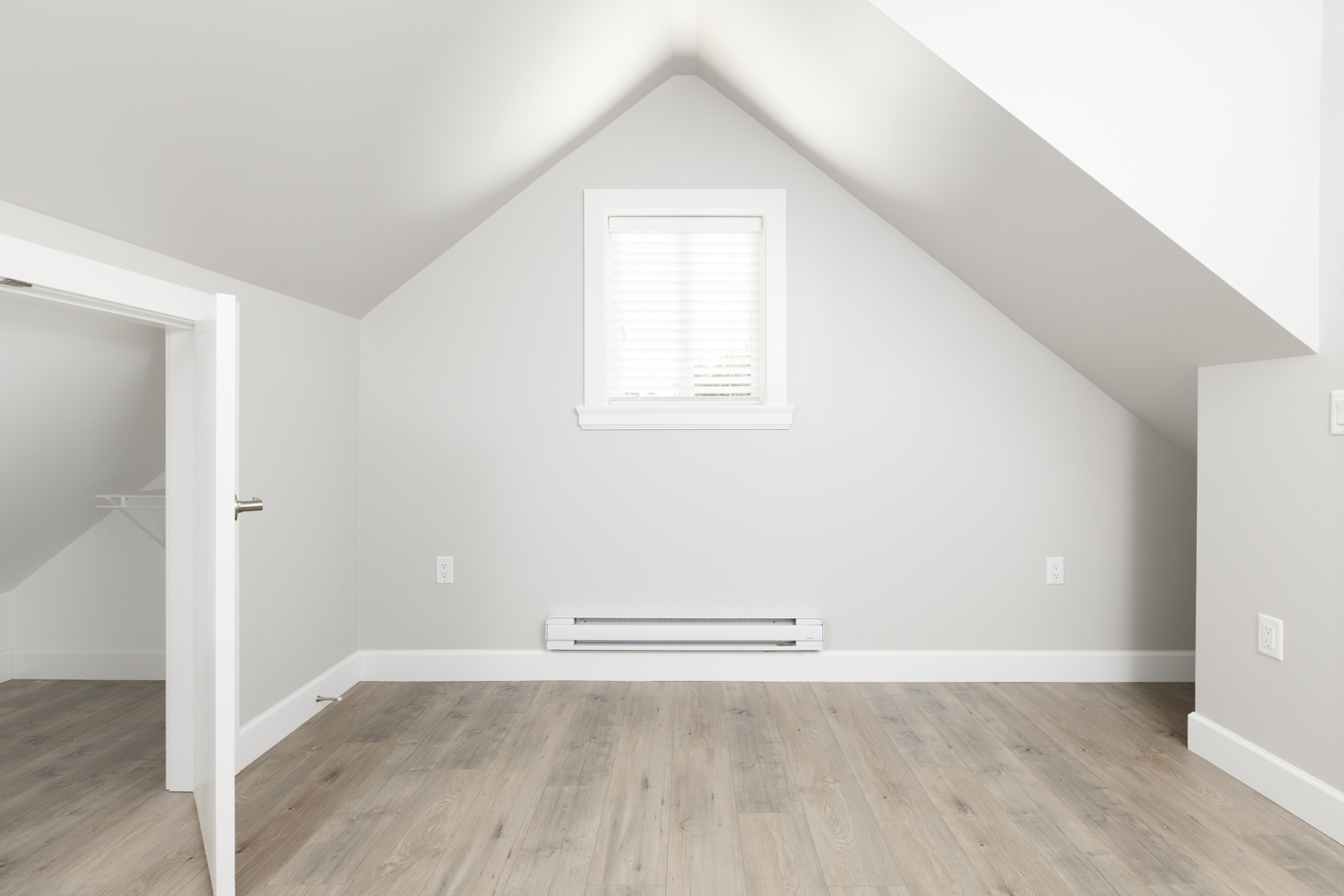 Uppermost floor of Vancouver unfurnished rental with sloped ceiling.