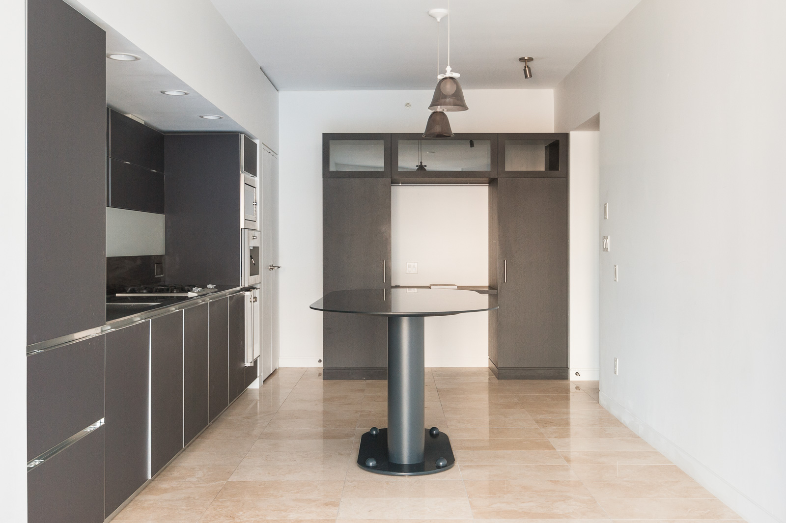 Kitchen with black cabinetry in Vancouver luxury condo rental managed by Birds Nest Properties..