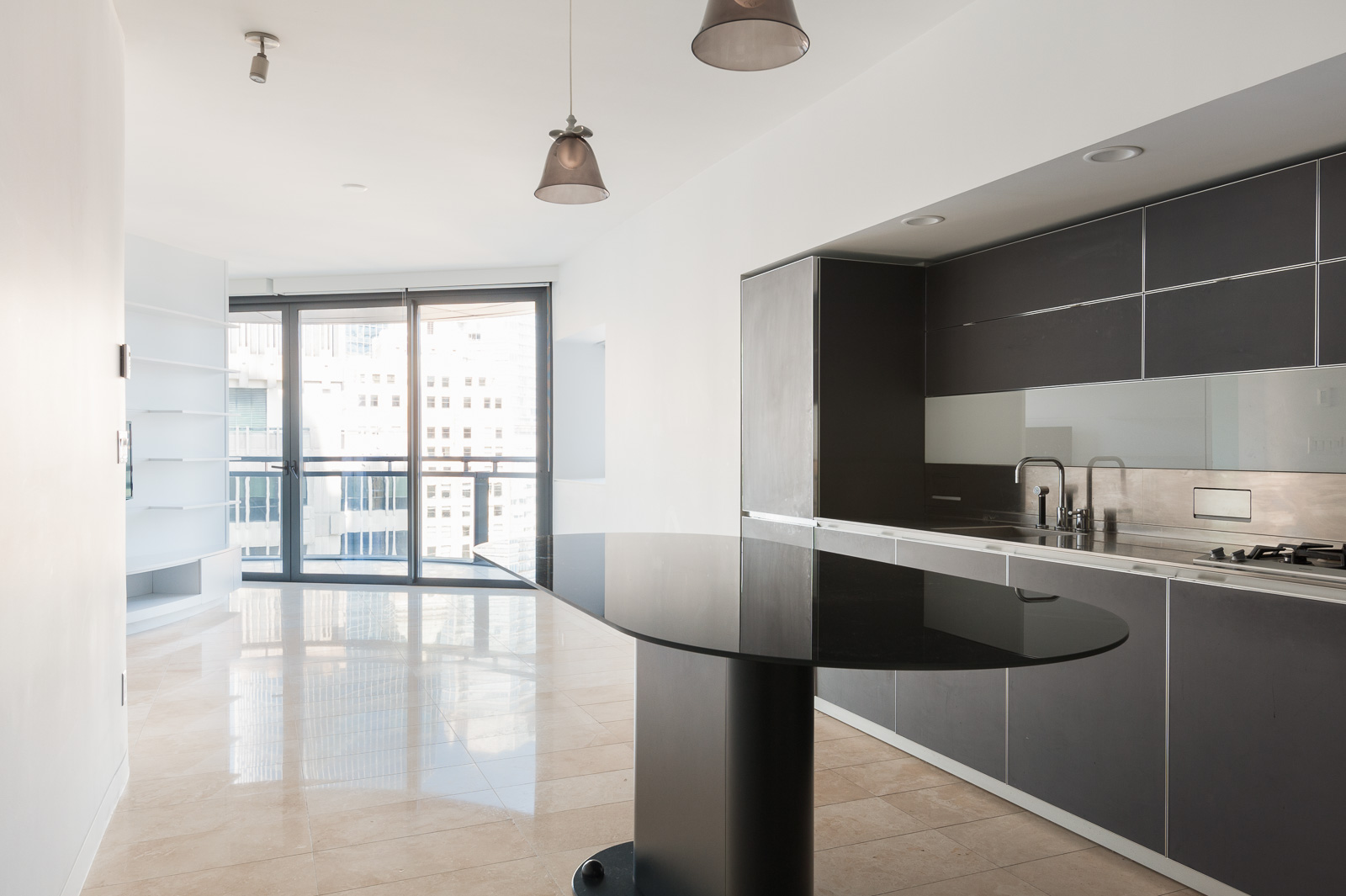 Oval, black kitchen island in luxury Downtown Vancouver rental.