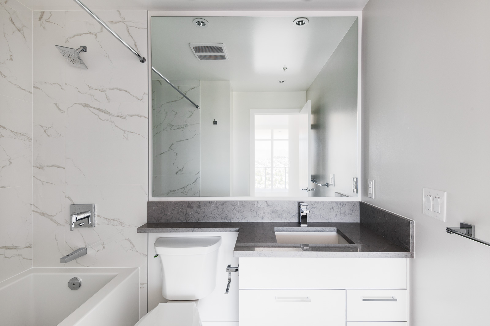 Bathroom with marble tiling in Brentwood condo