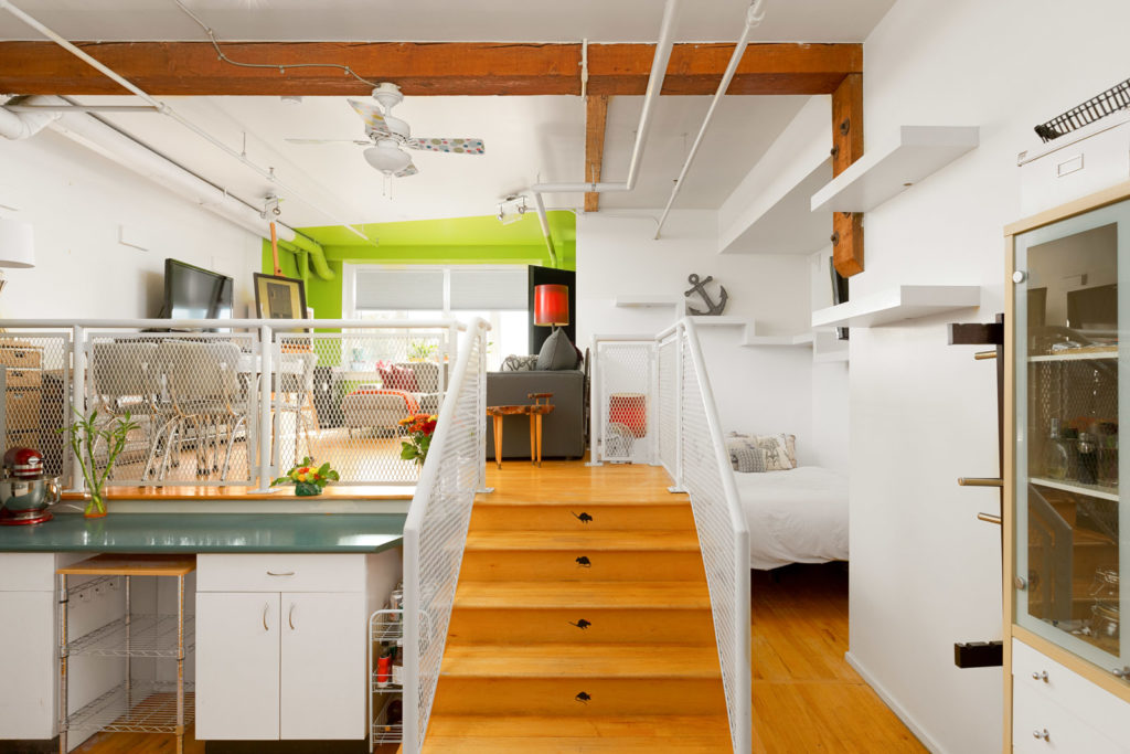 steps in a rental condo with old wood beams