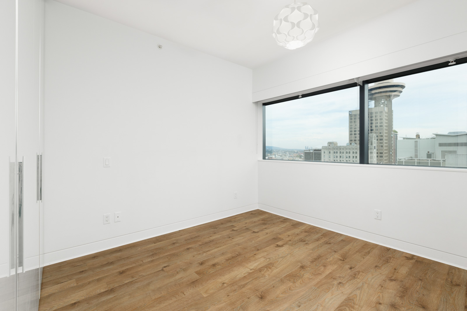 Bedroom with window in Jameson House condo in Downtown Vancouver