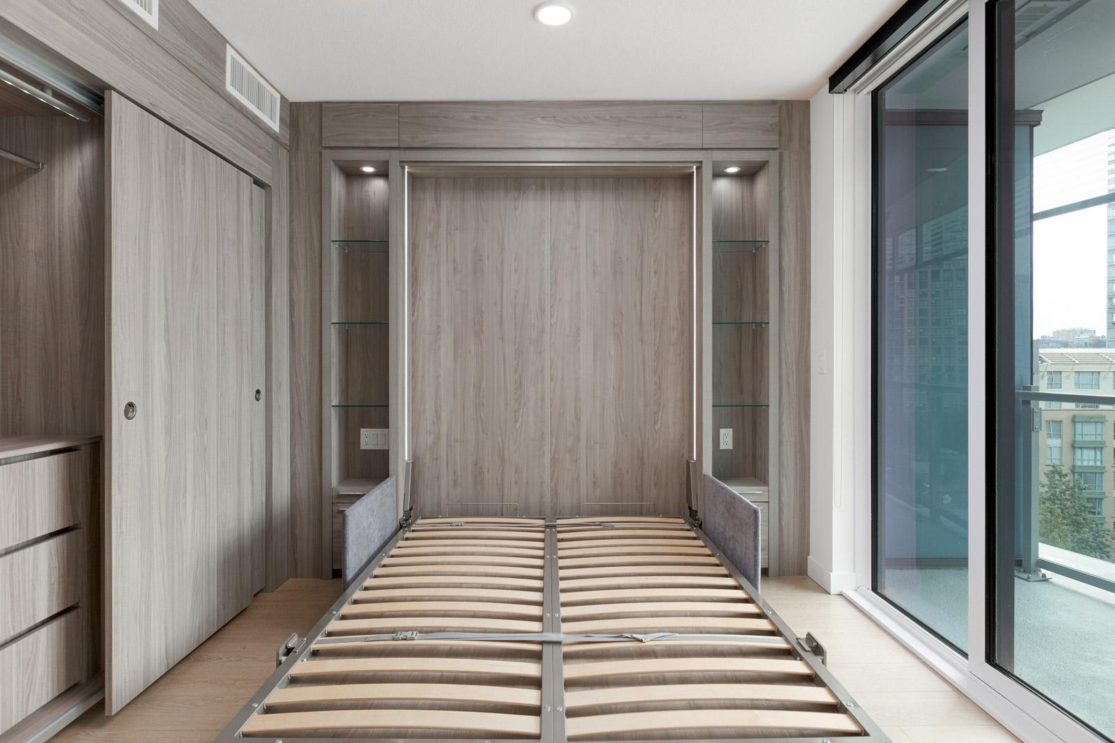 murphy bed down in bedroom of arc rental condo with dark wood walls