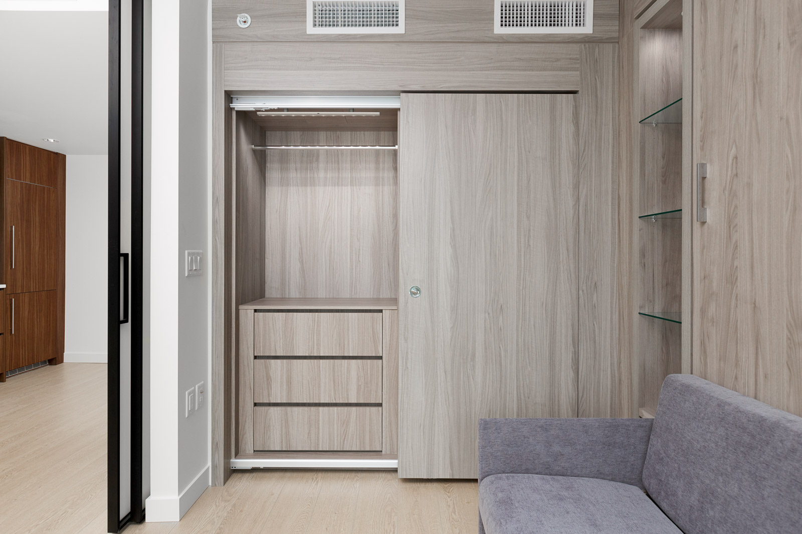 bedroom closet with shelving in arc rental condo unit