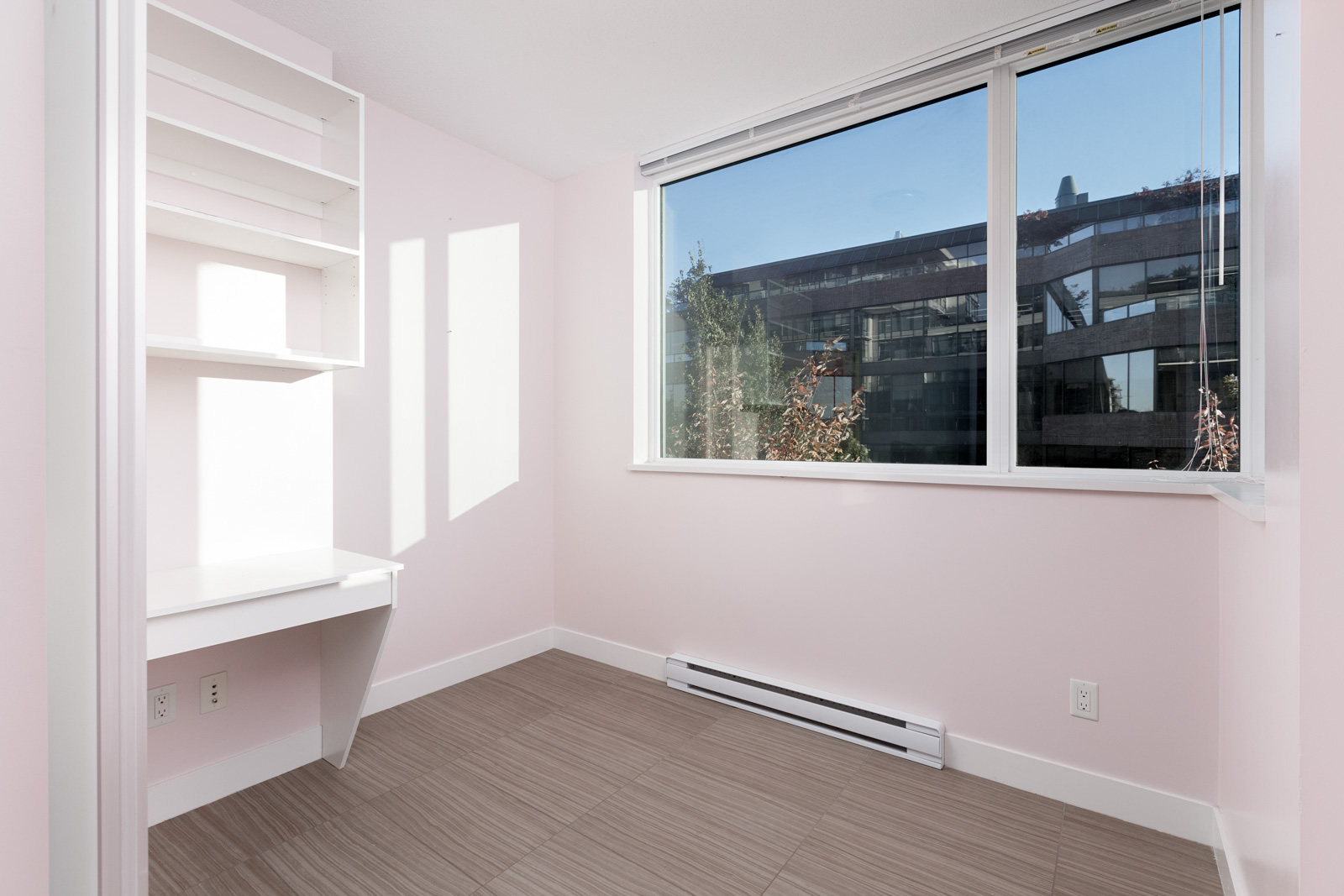 Bedroom with sunlight coming in from window in Kits360 condo rental