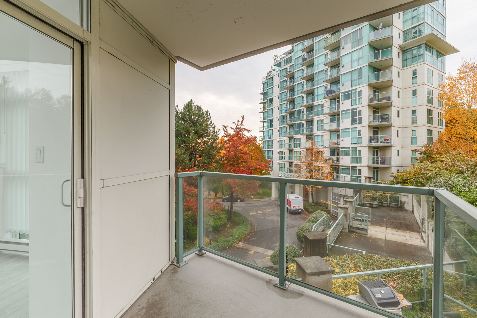 Balcony with view of adjacent building from River Dance building in River District Vancouver rental condo property