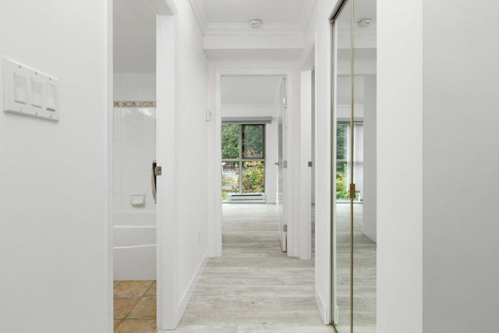 Hallway with mirrored closet doors in River Dance building in River District Vancouver rental condo property