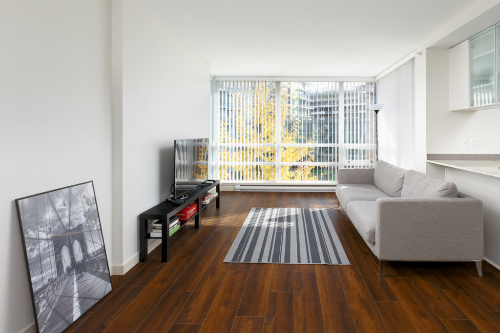 living room in richmond condo with wooden floors and bright view