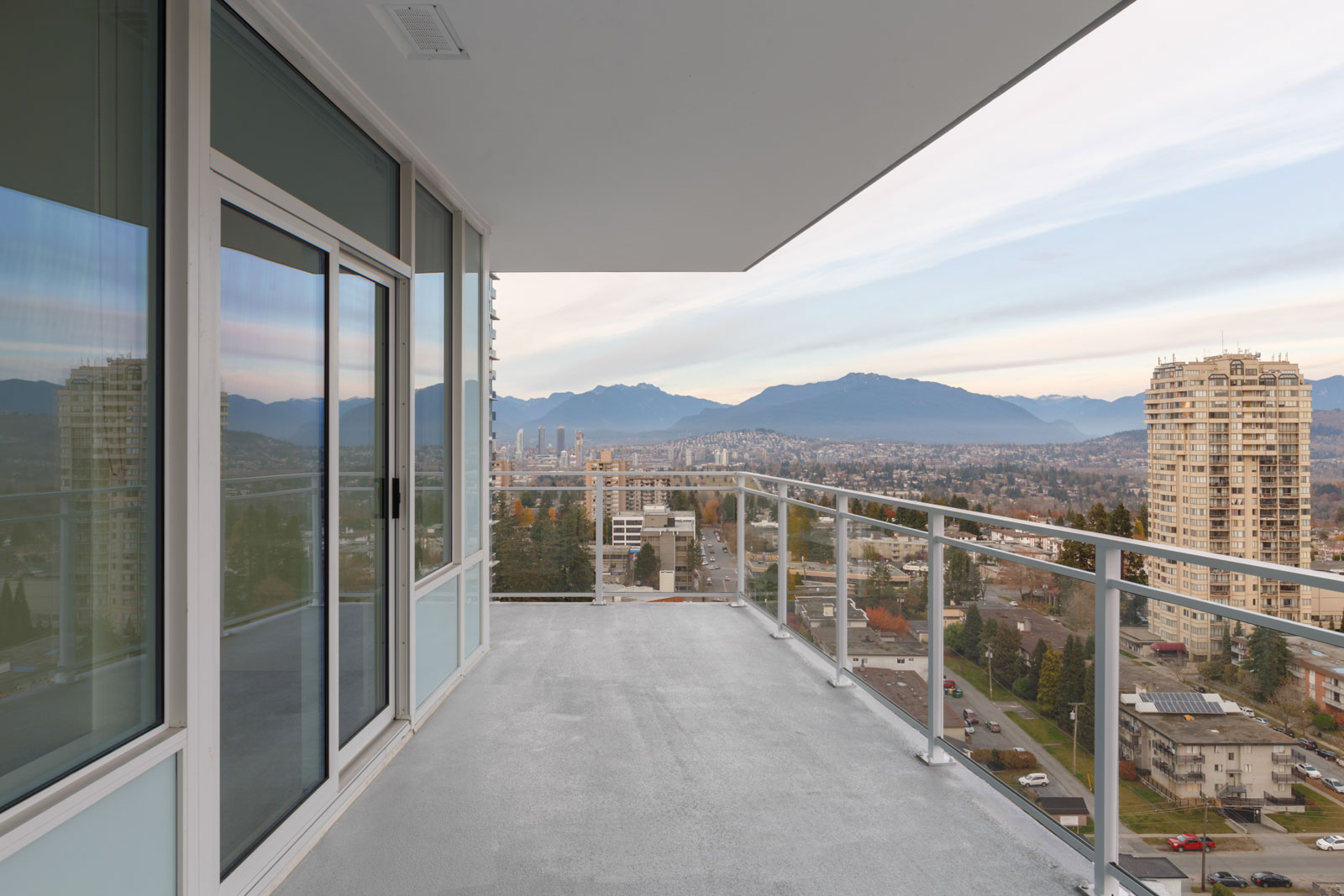 balcony with mountain view and clear skies from imperial street metrotown burnaby condo for rent